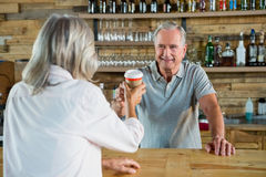 Free Senior Man Serving Coffee To Woman Royalty Free Stock Images - 90527499