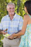 Senior Man Serving Food At Family Barbeque Royalty Free Stock Image