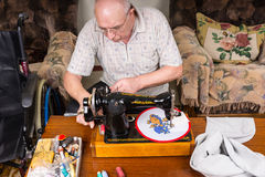 Senior Man Sewing Needle Point Craft with Machine