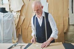 Senior Man Sewing Tailored Suit Royalty Free Stock Image