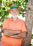 Senior Man in Shade. Handsome senior man wearing a panama hat and standing in the shade royalty free stock photos