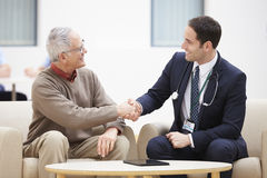 Senior Man Shaking Hands With Doctor Royalty Free Stock Photos