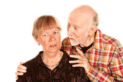 Senior man sharing information with concerned wife Royalty Free Stock Photo