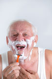 Senior man shaving his beard Royalty Free Stock Images