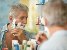 Senior man shaving Royalty Free Stock Photo