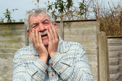 Senior man is shocked. Royalty Free Stock Images