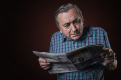 Senior man shocked with news Royalty Free Stock Photography
