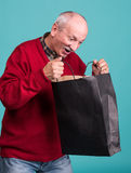 Senior man with shopping bag Stock Image
