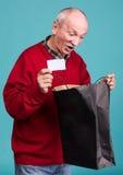 Senior man with shopping bag Stock Photography