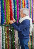 Senior Man Shopping For Tinsels Stock Image