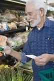 Senior Man Shopping For Vegetable  Royalty Free Stock Images