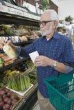 Senior Man Shopping For Vegetable  Royalty Free Stock Photo