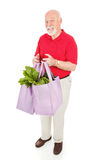 Senior Man Shops Green Stock Photo
