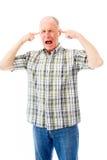 Senior man shouting in frustration Stock Photo