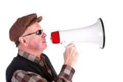 Senior Man Shouting Through Megaphone Royalty Free Stock Photography