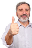 Senior man show big finger, good gesture. Isolated Stock Images