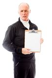 Senior man showing a clipboard Stock Photo