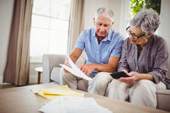 Senior man showing documents to woman Royalty Free Stock Photos