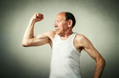 Senior man showing the muscles Stock Photography