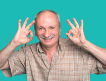 Senior man showing ok sign Stock Photo