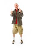 Senior man showing thumbs up gesture Royalty Free Stock Photography