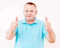 Senior man showing thumbs up over white Stock Images