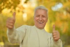 Senior man showing Royalty Free Stock Photography