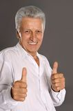 Senior man showing thumbs up Royalty Free Stock Photography