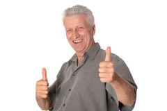 Senior man showing thumbs up Royalty Free Stock Images