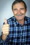Senior man shows OK sign Stock Images