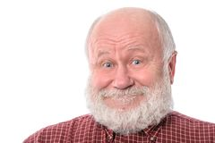 Senior man shows surprised smile facial expression, isolated on white. Handsome bald and bearded senior man shows surprised smile grimace or facial expression Royalty Free Stock Photography