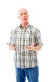 Senior man shrugging with raised hands Stock Photos
