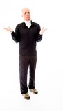 Senior man shrugging with raised hands Royalty Free Stock Photography