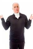 Senior man shrugging with raised hands Royalty Free Stock Photo