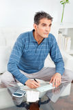 Senior man signing check Royalty Free Stock Photos