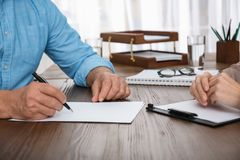Senior man signing document