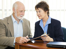 Senior Man Signs Paperwork - Serious Royalty Free Stock Images