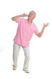 Senior man singing karaoke. Portrait of senior man singing karaoke isolated on white background Royalty Free Stock Images