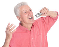 Senior man singing karaoke. Portrait of senior man singing karaoke isolated on white background Royalty Free Stock Photography