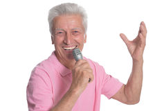 Senior man singing karaoke. Portrait of senior man singing karaoke isolated on white background Stock Image