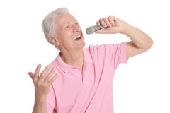 Senior man singing karaoke. Portrait of senior man singing karaoke isolated on white background Stock Photo