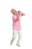 Senior man singing karaoke. Portrait of senior man singing karaoke isolated on white background Royalty Free Stock Image