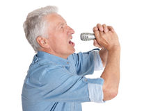 Senior man  singing into microphone Royalty Free Stock Photography
