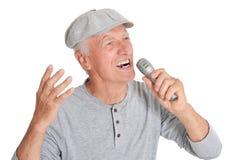 Senior man  singing into microphone Stock Photography