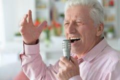 Senior man singing Royalty Free Stock Images