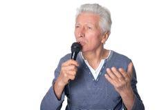 Senior man singing songs Royalty Free Stock Photos