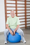 Senior Man Sits on a Fitball Stock Images