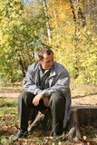 Senior man sits in the park Stock Image