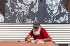Senior man on bench Stock Photography