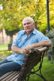 Senior  man   sitting on   bench Royalty Free Stock Images